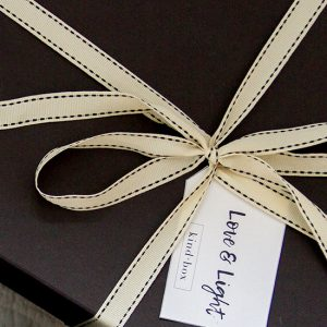 black box with gift tag