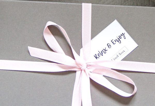 grey box with gift tag