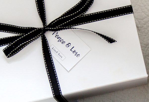 white box with gift tag